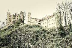 Hohenschwangau. Castel in the Bavarian alps with the sky as copy space Stock Photo