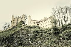 Hohenschwangau. Castle in the Bavarian alps with the sky as copy space Stock Photography
