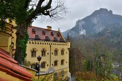 Hohenschwangau castle in Germany. View with mountains. Raining frog mood Royalty Free Stock Photo