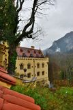 Hohenschwangau castle in Germany. View with mountains. Raining frog mood Royalty Free Stock Photos