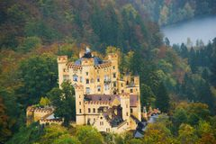 Hohenschwangau Castle surrounded by a colorful autumn forest stock image