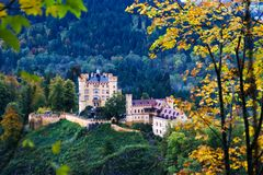 Hohenschwangau Castlesurrounded by a colorful autumn forest stock image