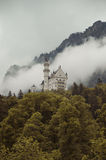 Hohenschwangau,  Germany- May 24, 2015: View of Neuschwanstein Castle in Bavaria, near Munich, on a stormy day. Royalty Free Stock Photo