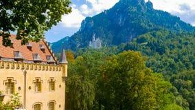 Hohenschwangau and Neuschwanstein Castles. Fussen, Germany - August 13, 2018 : View of Neuschwanstein Castle from Hohenschwangau Castle`s garden royalty free stock photography