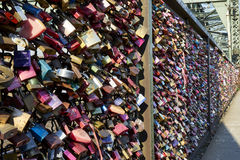 Hohenzollern Bridge with amazing plethora of love locks. Love locks are placed on bridges or chain link fences to symbolize the lovers` commitment to each other stock photography