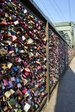 Hohenzollern Bridge with amazing plethora of love locks. Love locks are placed on bridges or chain link fences to symbolize the lovers` commitment to each other royalty free stock images