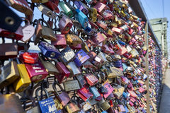Hohenzollern Bridge with amazing plethora of love locks. Love locks are placed on bridges or chain link fences to symbolize the lovers` commitment to each other stock photos