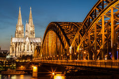 Hohenzollern bridge and Cologne cathedral at dusk Stock Photos