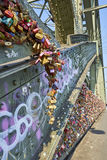 Hohenzollern Bridge with graffiti and love locks. Love locks are placed on bridges or chain link fences to symbolize the lovers` commitment to each other royalty free stock image