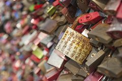 Hohenzollern railway Bridge in Cologne or famous Cologne`s Love Locks Bridge with thousands padlocks left by lovers. Royalty Free Stock Image