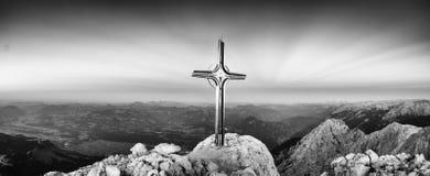Hoher Goell autumn daybreak panorama. Iron cross at mountain top Stock Photography