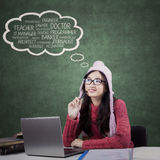 Hoher Schüler denkt ihre Traumjobs Stockfoto