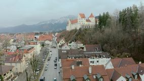 Hohes Schloss Fussen. Hohes Schloss Fusse of the Bishops aerial panoramic view, Germany. Beautiful Gothic High Castle on a hill above Fuessen old town in Swabia stock video