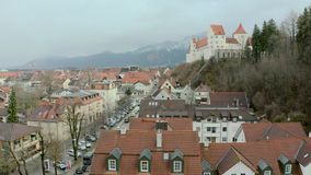 Hohes Schloss Fussen. Hohes Schloss Fusse of the Bishops aerial panoramic view, Germany. Beautiful Gothic High Castle on a hill above Fuessen old town in Swabia stock footage