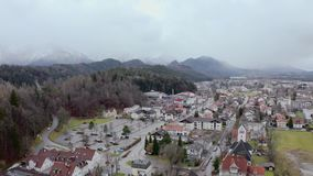 Hohes Schloss Fussen. Aerial panoramic view of Fussen, Germany, beautiful gothic old town in Swabia. Top view of europian red roofs stock footage