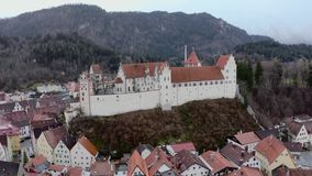 Hohes Schloss Fussen. Hohes Schloss Fusse of the Bishops aerial panoramic view, Germany. Beautiful Gothic High Castle on a hill above Fuessen old town in Swabia stock video footage