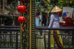 Hoi An, bridge. Woman walking a bridge in Hoi An Vietnam Royalty Free Stock Photography