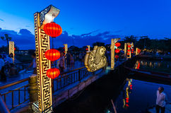 Hoi An city lights and a pedestrian bridge over the Thu Bon river in Vietnam Royalty Free Stock Photography