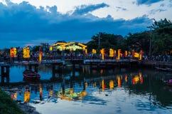 Hoi An city lights and a pedestrian bridge over the Thu Bon river in Vietnam Royalty Free Stock Photos