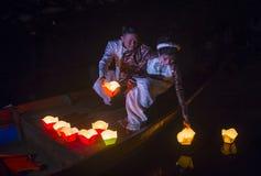 The Hoi An Full Moon Lantern Festival. HOI AN , VIETNAM - OCT 04 : Vietnamese couple dropping lanterns into the river in Hoi An , Vietnam during the Hoi An Full Stock Image
