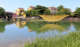 Hoi An river view. View over the Thu Bon river in Hoi An, Vietnam, with a fishing net hanging over the river Royalty Free Stock Photo