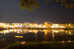 Hoi An town by night beside Hoai river Royalty Free Stock Photo