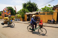 Hoi An, Vietnam - 13 April 2013: A garbage collector and her bicycle, Hoi An Ancient Town Stock Photography