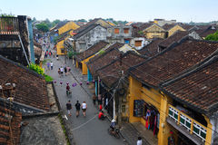 Hoi An, Vietnam - 14 April 2013: Hoi An Ancient Town view from top, there are many tourists on main street of the ancient town. Royalty Free Stock Photos