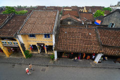 Hoi An, Vietnam - 14 April 2013: Hoi An Ancient Town view from top, there are many tourists on main street of the ancient town. stock photo