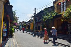 HOI AN, VIETNAM - April 5 2019: People walking on the streets of old town Hoi An, Vietnam royalty free stock image