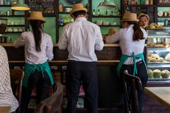 Hoi An, Vietnam - April 20, 2018: Waiter and waitresses check an order at a bar in Hoi An. stock image