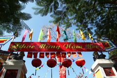 Festive colorful decorations on a building for celebrating Tet - Vietnamese New Year. stock photos