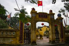Entrance gate of yard ancient pagoda in Hoi An old town, Vietnam royalty free stock photos