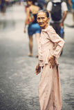 HOI AN, VIETNAM, JUNE 15: An elderly woman crossing the street a Royalty Free Stock Photography