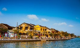 HOI AN, VIETNAM - MARCH 15, 2017: Ancient street view on a nice day. Stock Photo