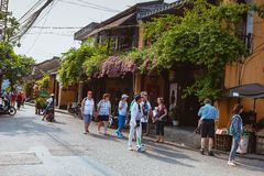 HOI AN, VIETNAM - MARCH 15, 2017: Group of people travel Hoian old town, ancient house, country heritage Stock Images