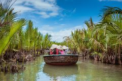 HOI AN, VIETNAM - MARCH 19, 2017: Tourists visit water coconut forest in Hoi An. Stock Images