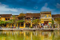 HOI AN, VIETNAM - MARCH 17, 2017: Traditional boats in front of ancient architecture in Hoi An, Vietnam Royalty Free Stock Images
