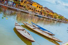 HOI AN, VIETNAM - MARCH 17, 2017: Traditional boats in front of ancient architecture in Hoi An, Vietnam Royalty Free Stock Photo