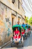 Hoi An - Vietnam Mars 16:: Den Cyclo trehjulingen i Hoi An ancien Royaltyfria Foton