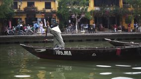Hoi An, Vietnam - May 10, 2018: View from the boat of the UNESCO-listed Hoi An Ancient Town and boats on the Thu Bon. River in Hoi An, Central Vietnam. Travel stock video