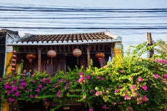 Hoi An, Vietnam - September 02, 2013: The couple is sitting on the balcony of the house Stock Photography