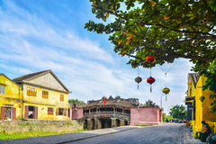 Hoi An, Vietnam - September 02, 2013: People are in the street around Japnaese covered bridge Stock Photo
