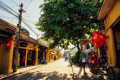 Hoi An, Vietnam - September 02, 2013: The tourist is walking in the street in the afternoon Stock Image
