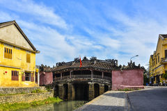 Hoi An, Vietnam - September 02, 2013: The woman is on the Japanese covered bridge Stock Photos
