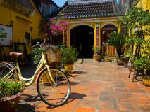 Hoian, Vietnam - August 20, 2017: Close up of a bike parked at backyard in the patio, in a house in Hoi An ancient town Stock Photos