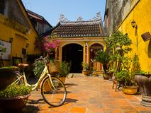Hoian, Vietnam - August 20, 2017: Close up of a bike parked at backyard in the patio, in a house in Hoi An ancient town Stock Photography