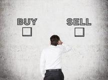 Hoice entre la compra y la venta Imagen de archivo libre de regalías
