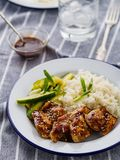 Hoisin Chicken. Traditional Asian cuisine. Chicken with sauce, r. Ice and pickled cucumbers royalty free stock images