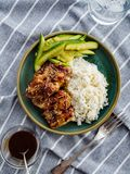 Hoisin Chicken. Traditional Asian cuisine. Chicken with sauce, r. Ice and pickled cucumbers royalty free stock image